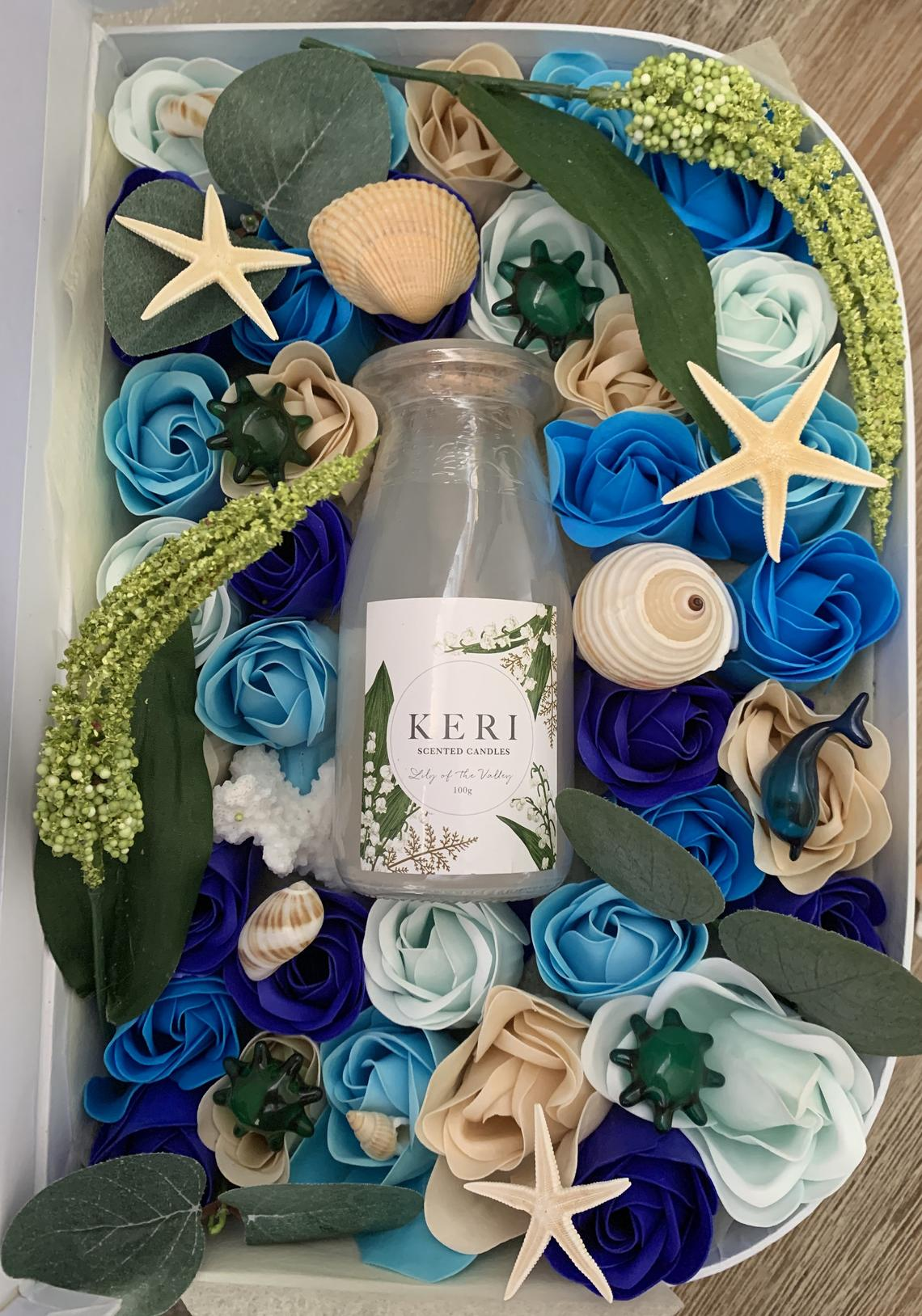 Soap Flowers in a blue suitcase beach theme with candle